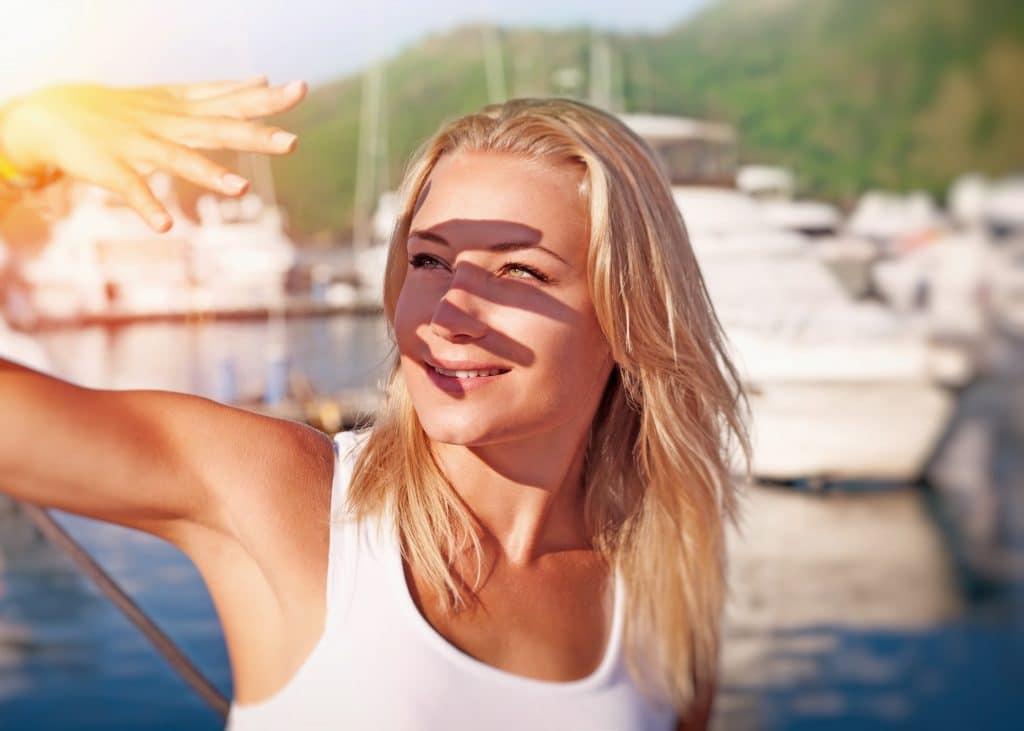 blonde girl with eye burns